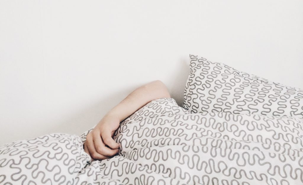 photo of person laying in bed